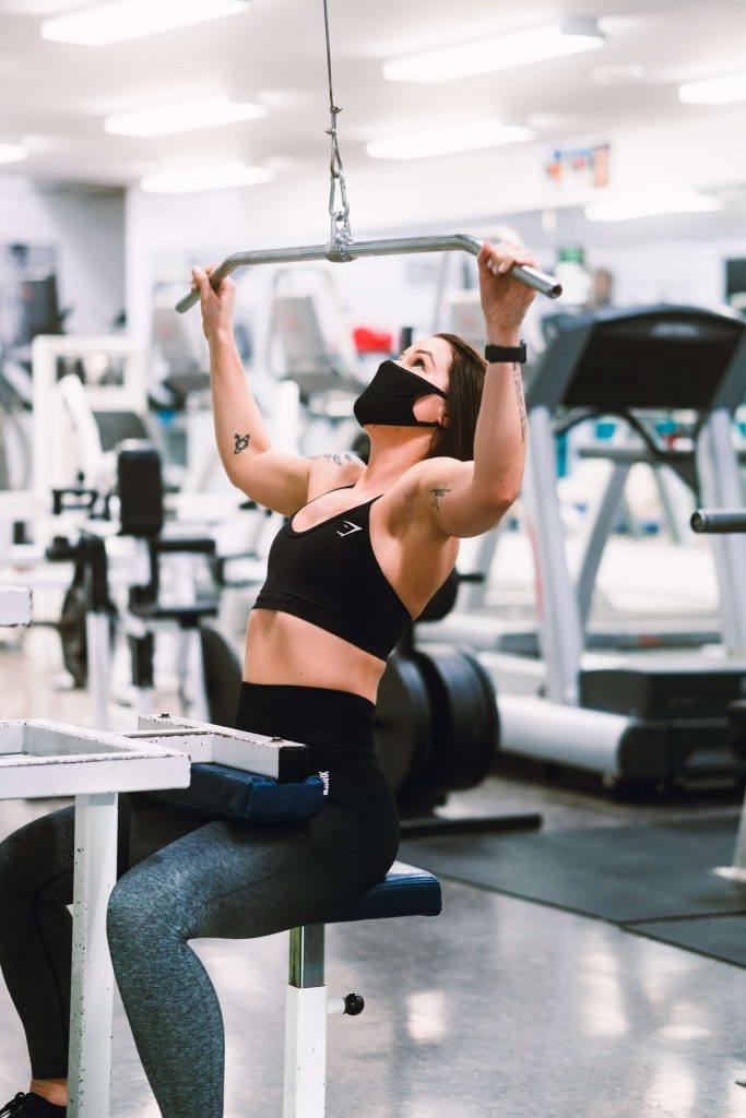 Masked woman working out
